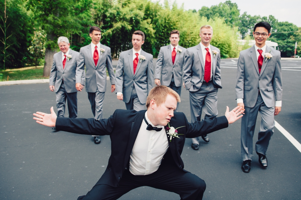 Groom being goofy while walking to his next photo location.