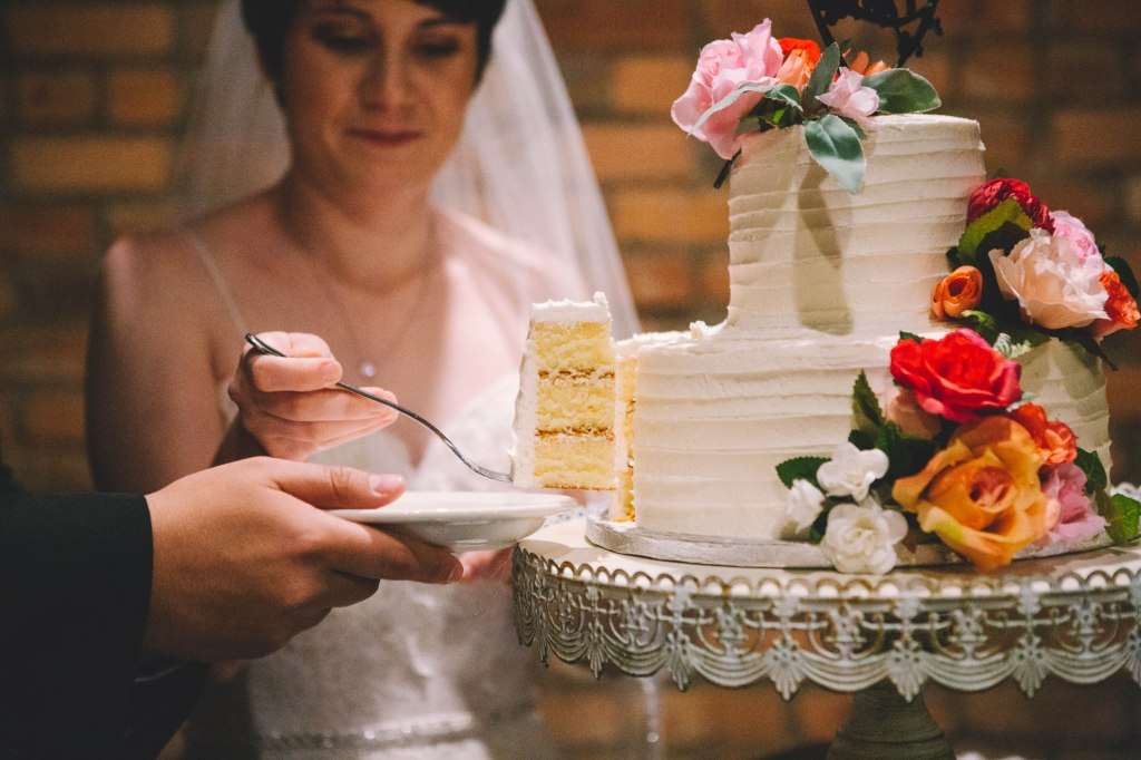 Close up shot of a piece of cake after the bride and groom have cut a slice.